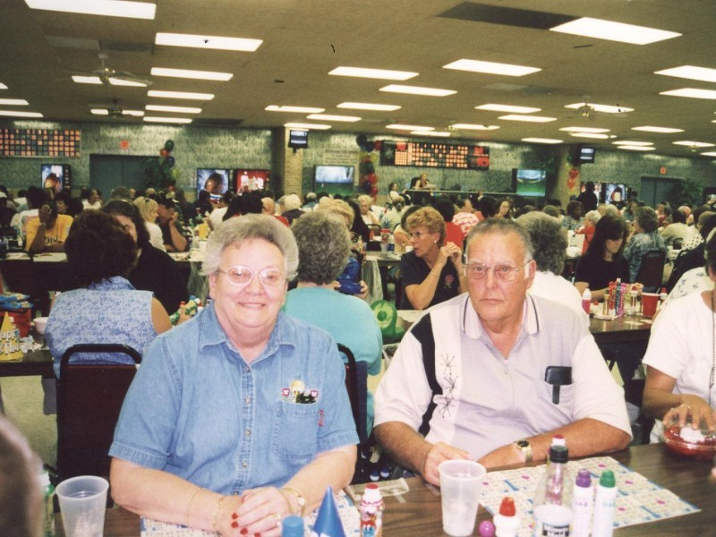 two bingo players in a full room