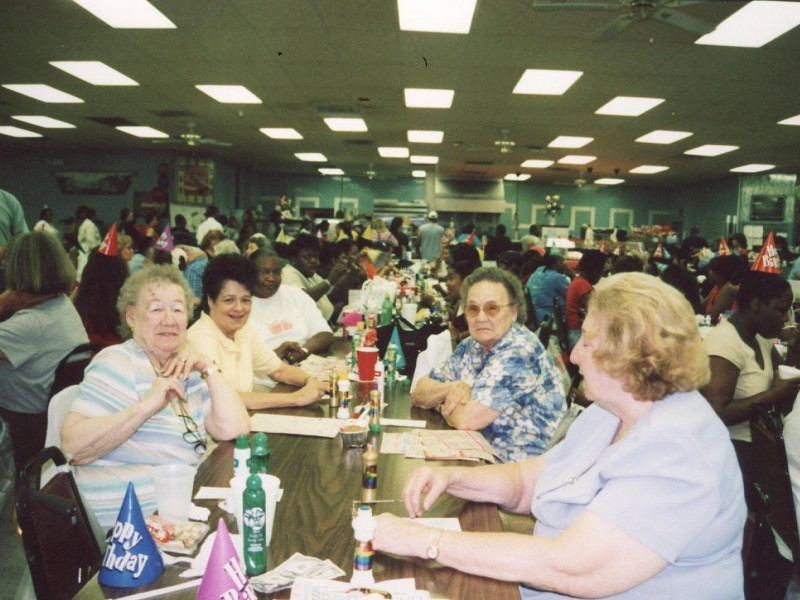 a group of older women playing bingo