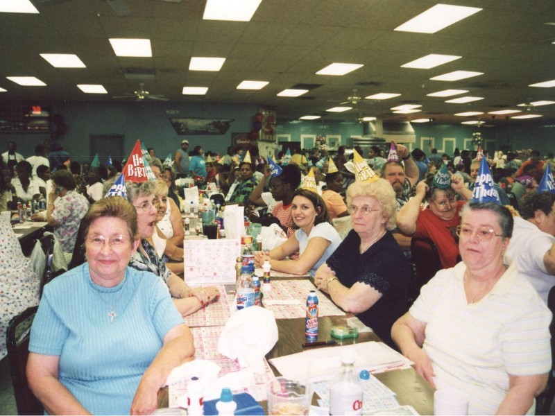 women gather around a table to play bingo