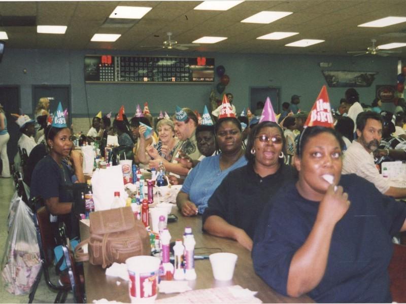 women in birthday hats play bingo