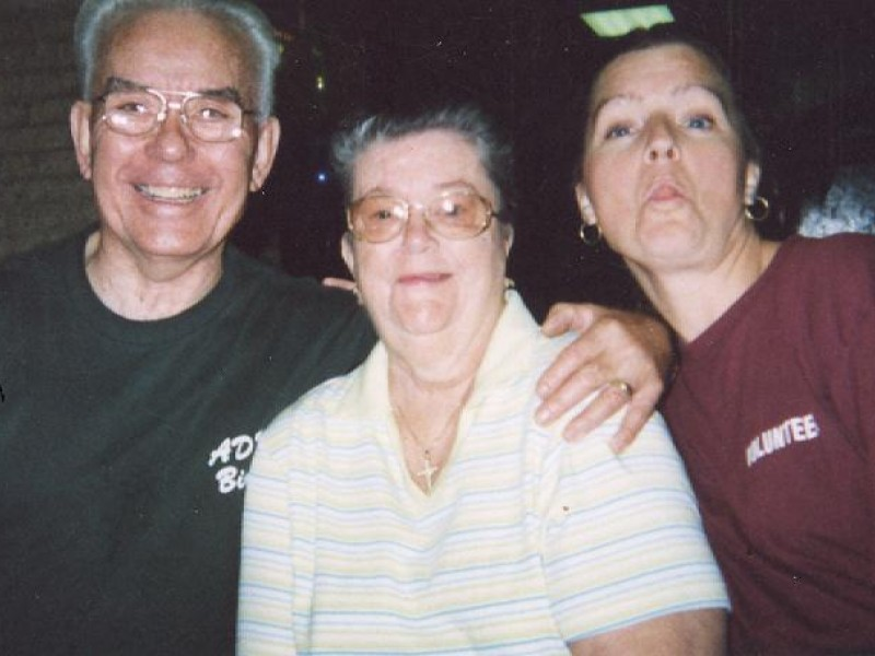 two woman and a man make faces at the camera