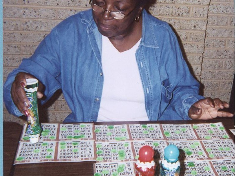a women stamps bingo cards