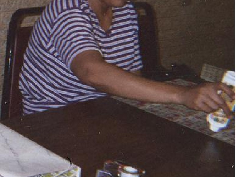 a woman with a stamp and bingo cards