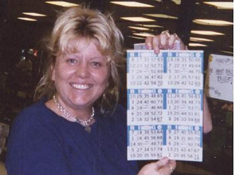 a women showing off bingo cards