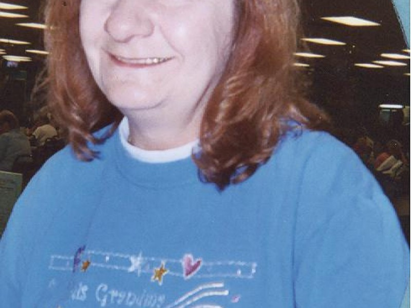 a women smiling with blue overlay