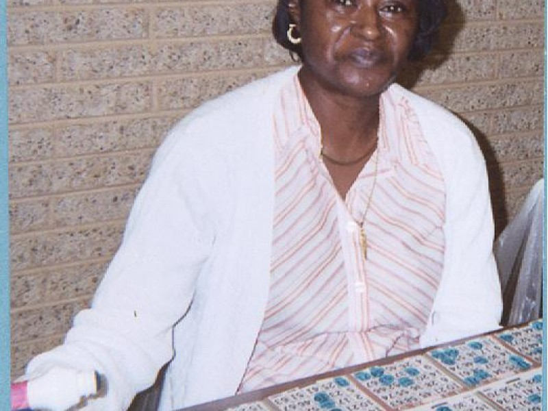a woman prepares to stamp bingo cards