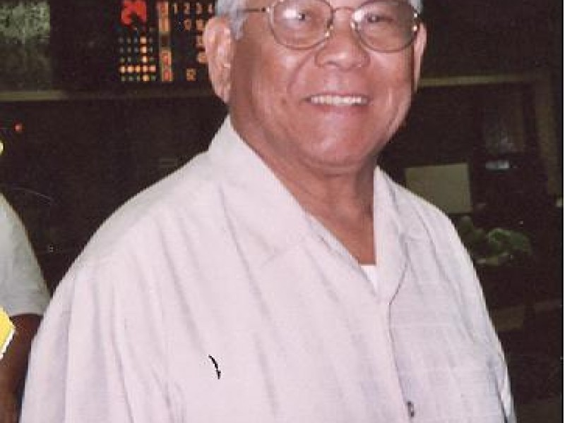 a man with glasses smiles at camera