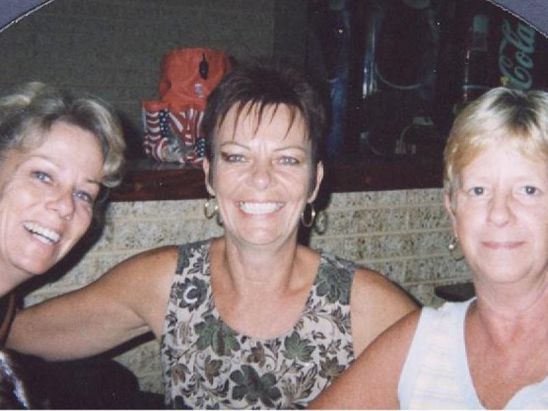 a trio of women smile at bingo