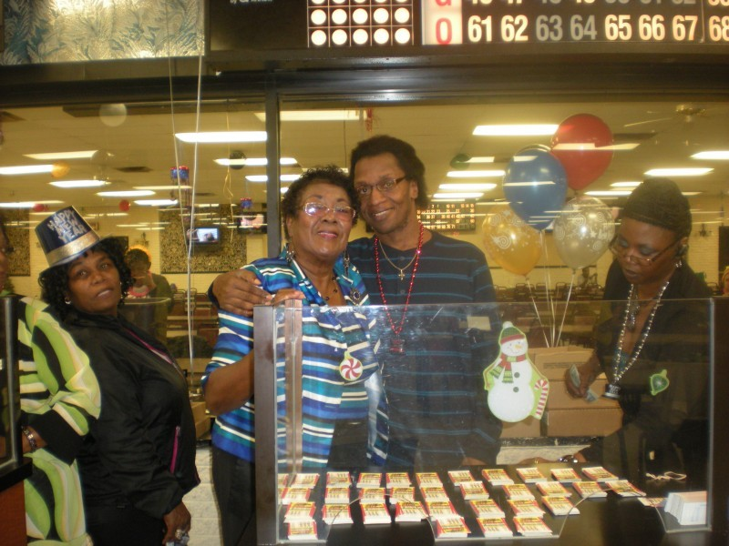 people hug at bingo counter