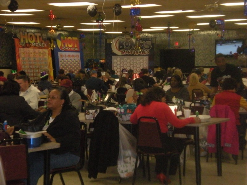 a room full of people playing bingo