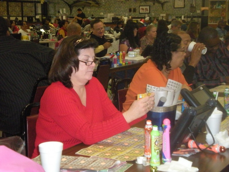 men and women play bingo