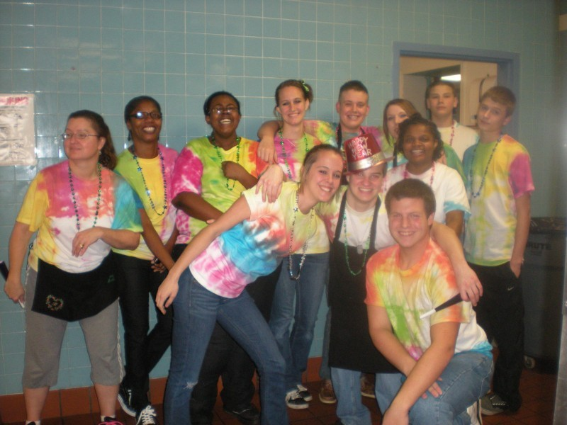 a group of people in tie dye shirts