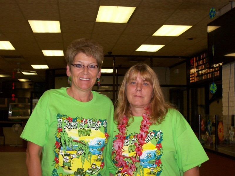 two women with green shirts