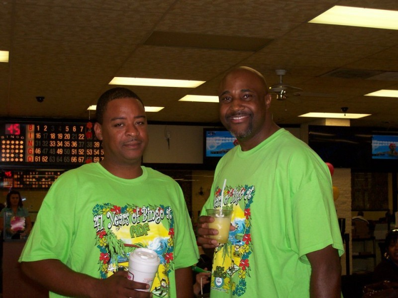 two men with green shirts