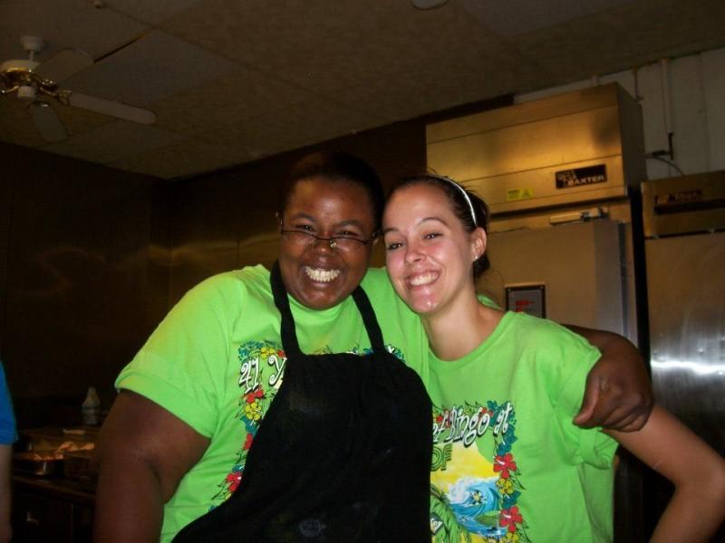kitchen workers hug