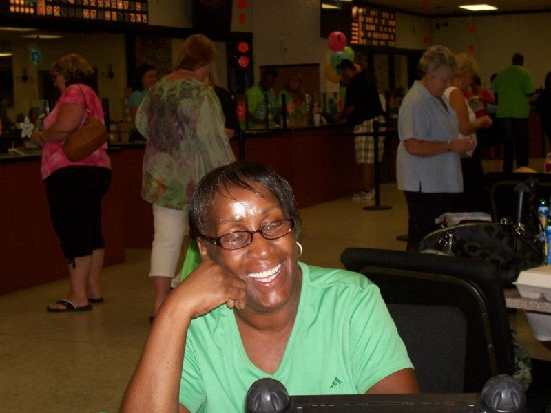 woman laughs and line of bingo players