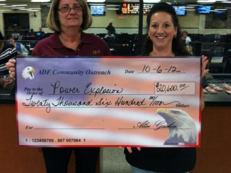 two women present an american flag check