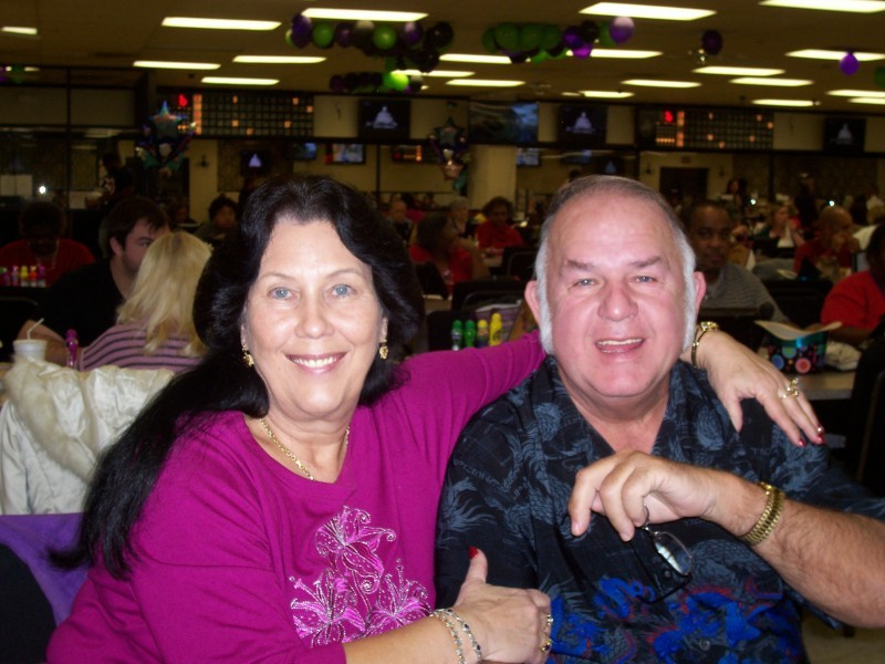couple smile at a bingo party
