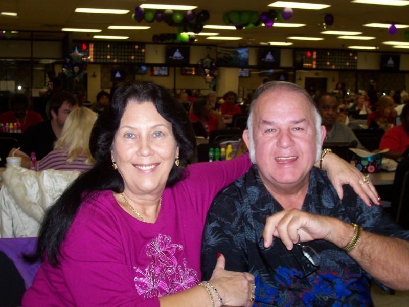 couple smile at a bingo party