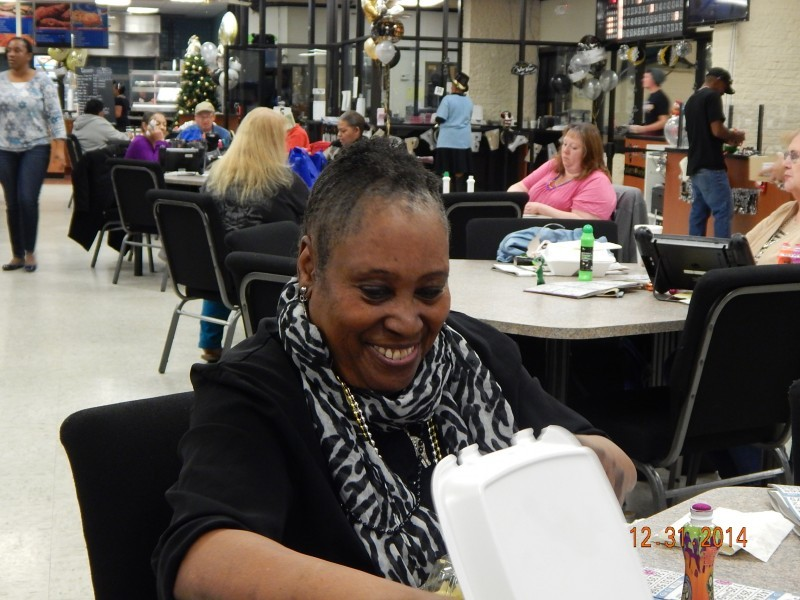 woman smiles at food container