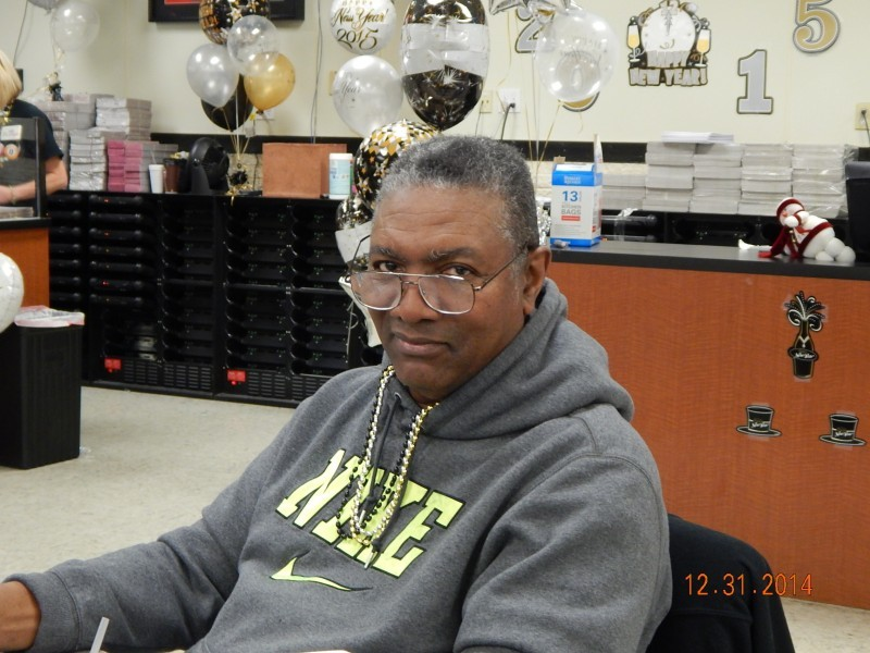 man looks over the tops of his glasses