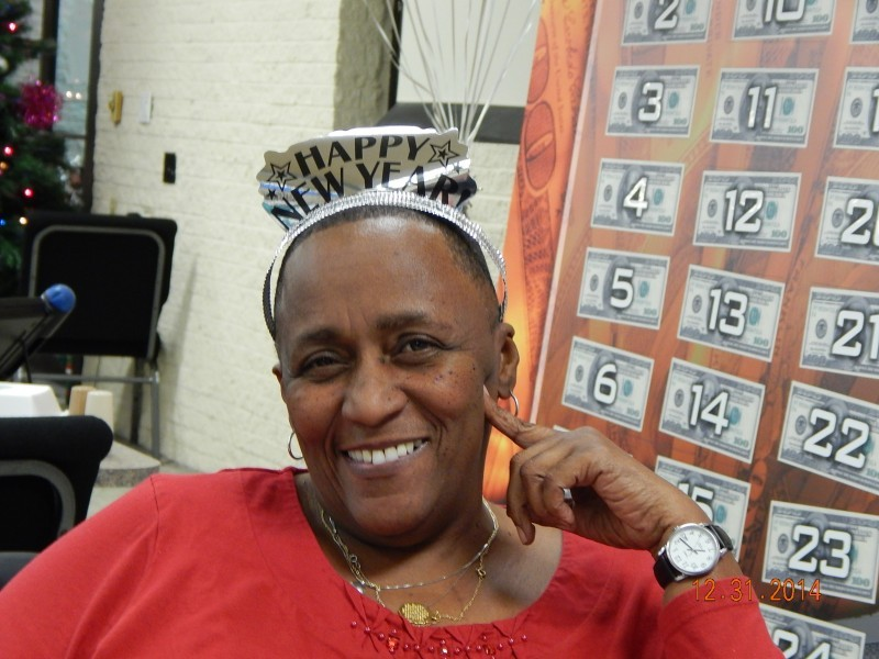 woman in happy new years tiara smiles