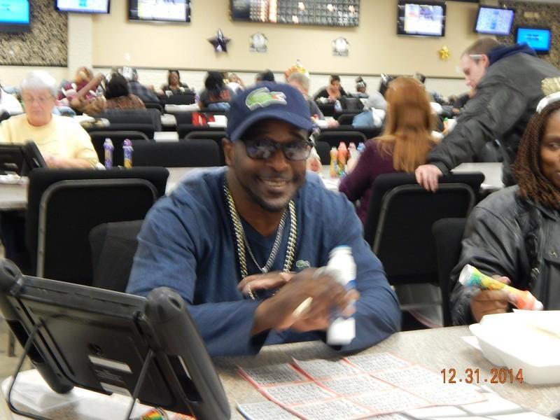 happy man in sunglasses plays bingo