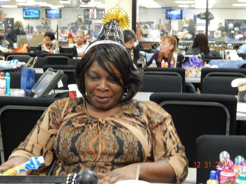 woman hunches back at bingo table
