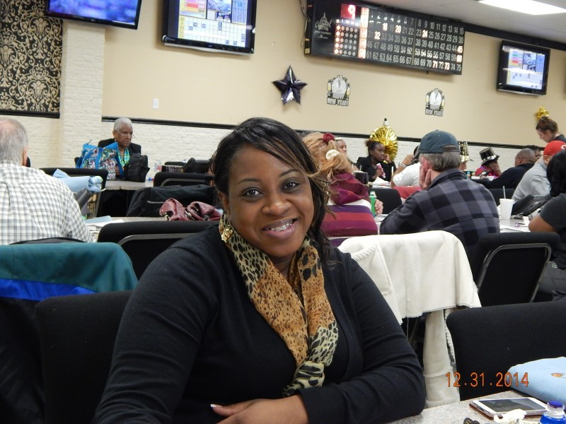 woman leans on a table at bingo