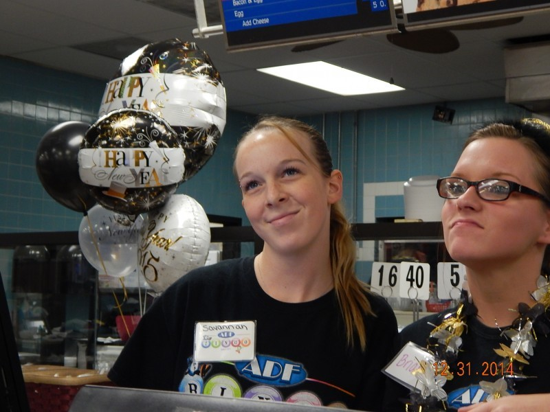 two women make faces while working at bingo