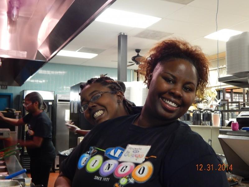 two happy women lean opposite
