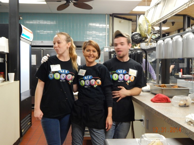 three employees try to take a picture