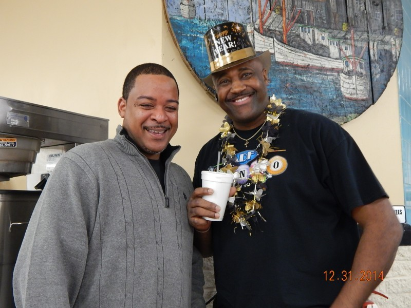 two men celebrate bingo at new years