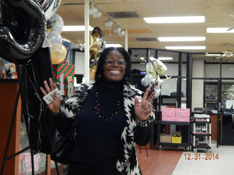 woman flashes a smile while throwing peace sign