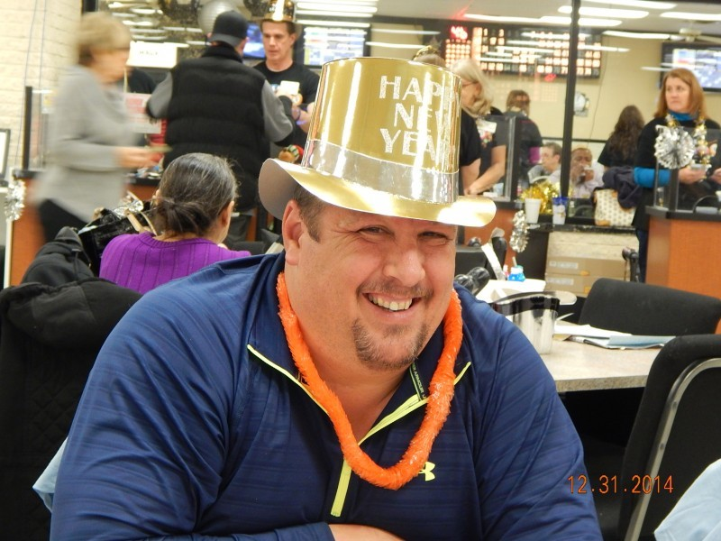 happy man in a bright gold top hat