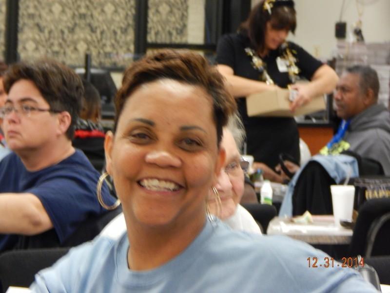 happy woman while sitting at bingo