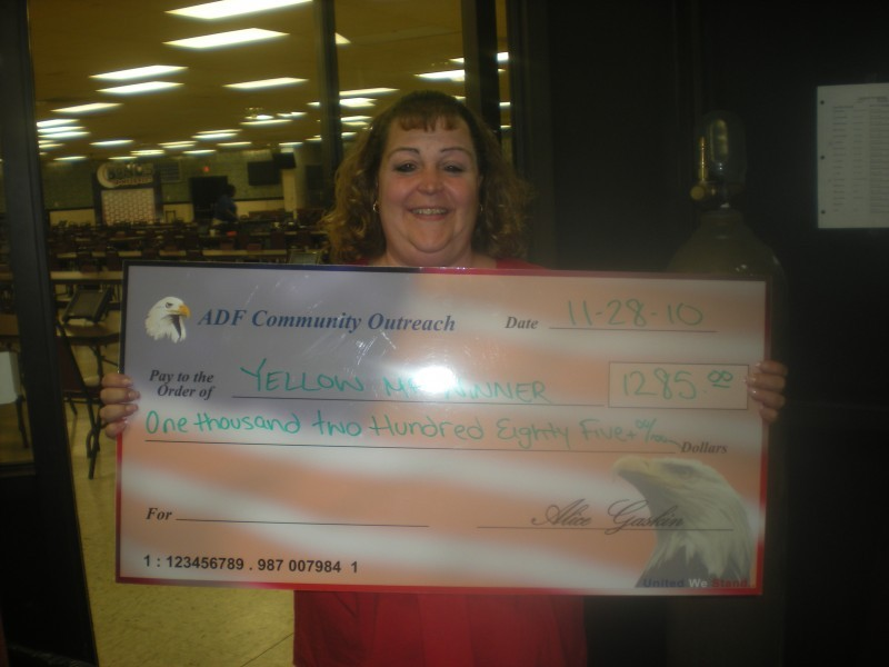 woman hold giant check