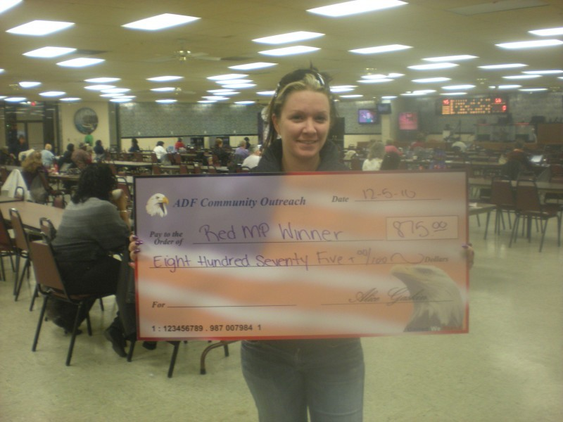 woman holding giant check