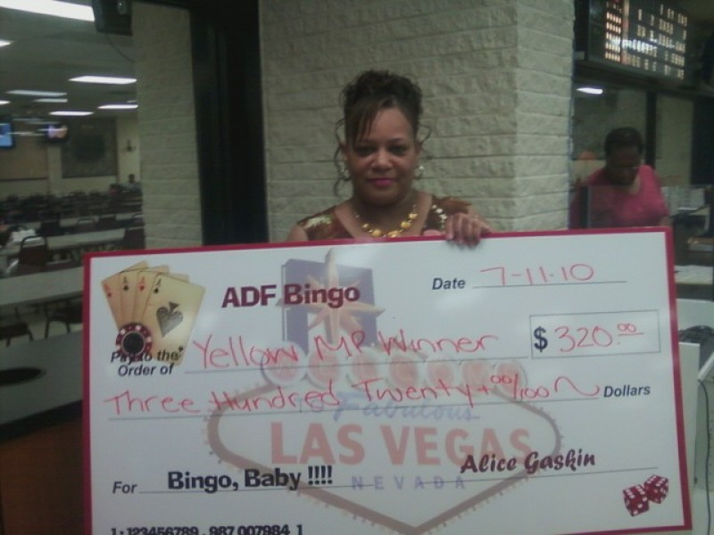woman shows large bingo check