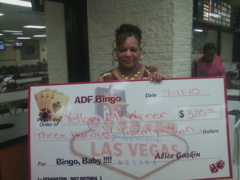 woman shows large bingo check