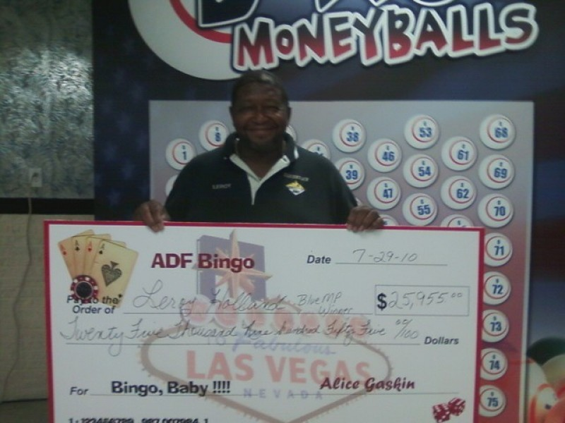 man shows off his giant bingo check