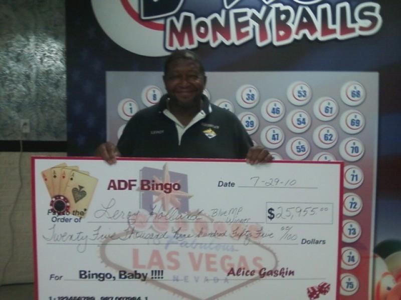 man shows off his giant bingo check