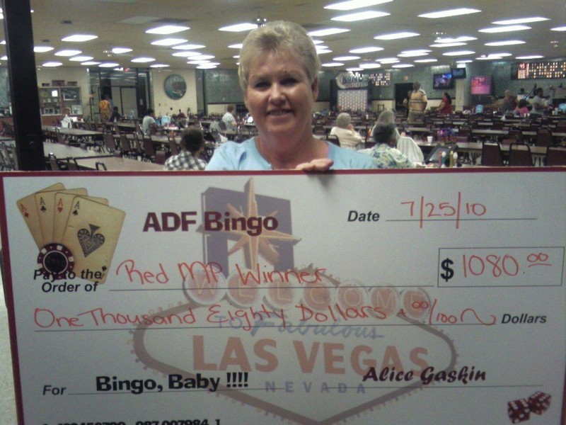 woman displays giant check for bingo