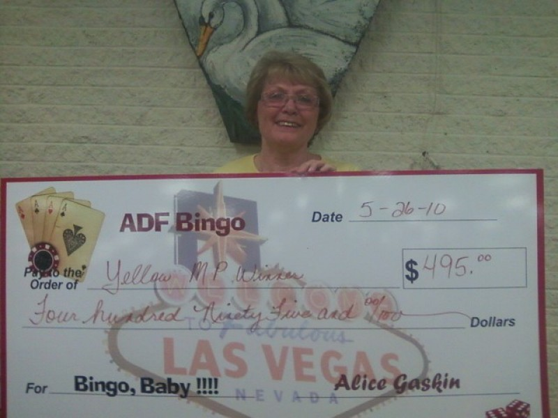 a woman stands behind bingo check