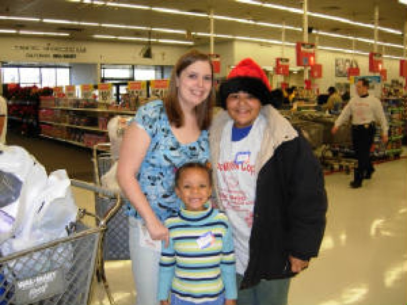 woman in store with two children
