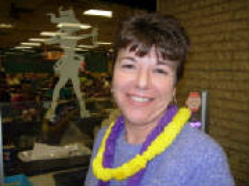 woman with yellow and purple leis