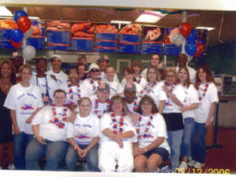 kitchen staff in matching white tee shirts