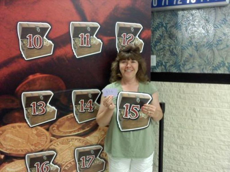 woman holds number 15 treasure chest