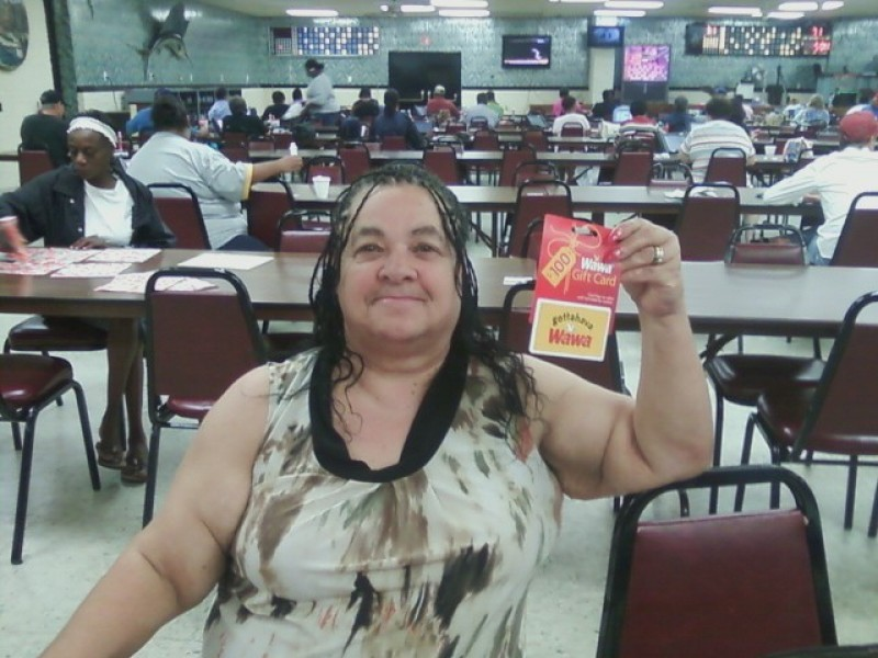 woman shows wawa gift card prize