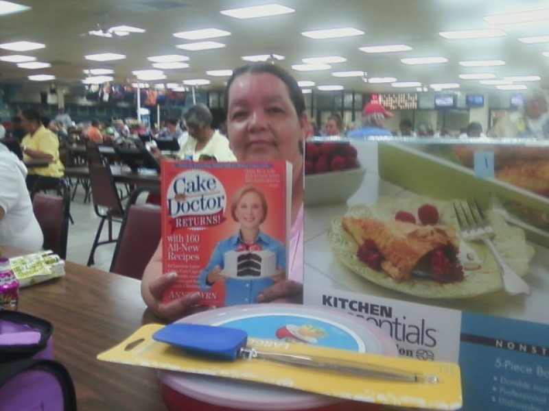 woman shows off prizes won at bingo